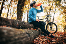 Young Man Is Cycling Through Forest