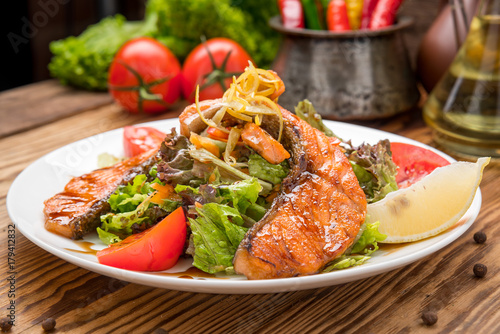 Salmon steak in white dish with vegetables Wallpaper Mural