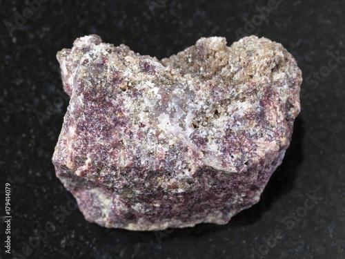 Fototapeta raw pink Dolomite stone on dark background obraz