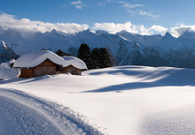 Mountain Cottage In Snow