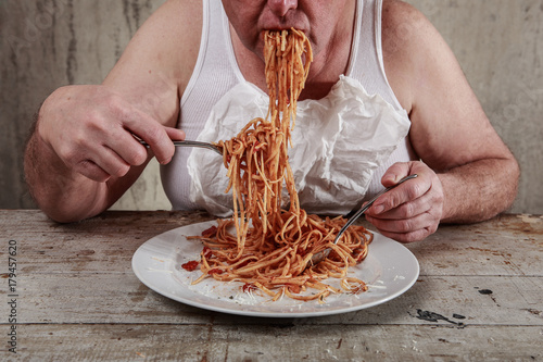 Man eating spaghetti, overeating adult. Canvas Print