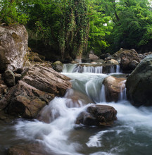 A Small Waterfall Among The Ro...