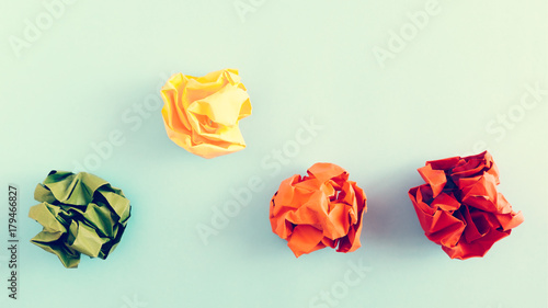 Fotografie, Obraz  Colorful crumpled paper balls on pastel blue colored background
