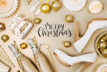 Flat Lay Stylish Set: Champagne, Gift, Female Shoes, Christmas Balls And Golden Holiday Decoration. Flat Lay, Top View.