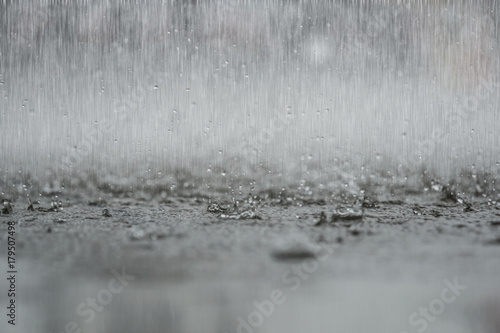 Foto auf Leinwand Wasserfalle black white abstract background raindrop on the ground