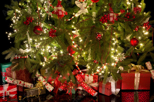Crackers and gifts under the christmas tree - Buy this stock photo ...