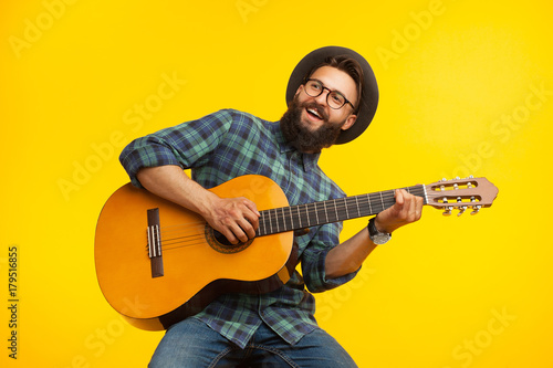 Cheerful musician with guitar - 179516855