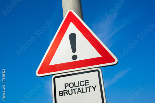 Police brutality - traffic sign with exclamation mark to alert, warn caution - p Fototapet