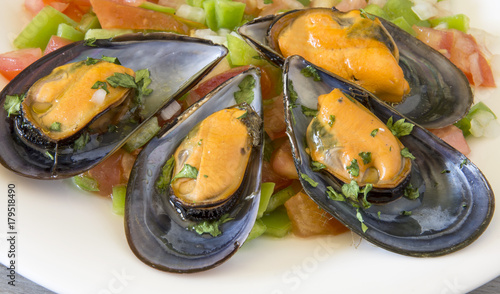 Fotografering  Vinaigrette mussels served on a plate.