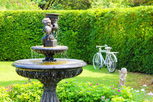 Garden With Small Fountain And...