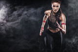 A strong athletic, woman sprinter, running on black background wearing in the sportswear, fitness and sport motivation. Runner concept with copy space. - 179536830