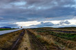Empty street with cloudy sky and Icelandic Landscape during Sunr