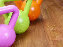 Green, Pink And Orange Kettlebells