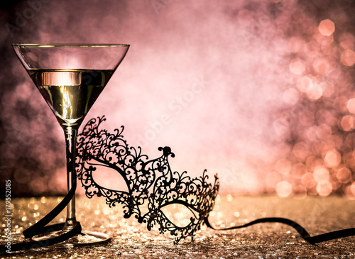 carnival mask and cocktail with glittering background