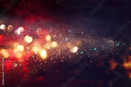Fotografie, Obraz  black and red glitter lights background. defocused