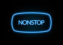 Nonstop  - Colorful Neon Sign On Brickwall