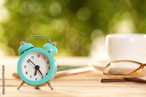 Alarm clock on table indoors. Morning routine concept Canvas Print