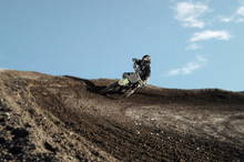 Motocross Driver On Race Track