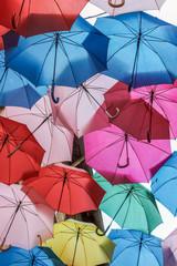 colorful umbrellas hanging in sky