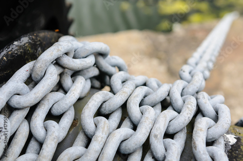 Chain on a winch at a harbour port Canvas