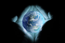 Men's Hands Holding The Planet...