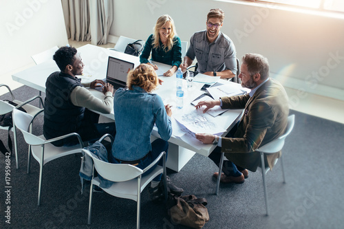 Obraz Group of business people in meeting at office - fototapety do salonu