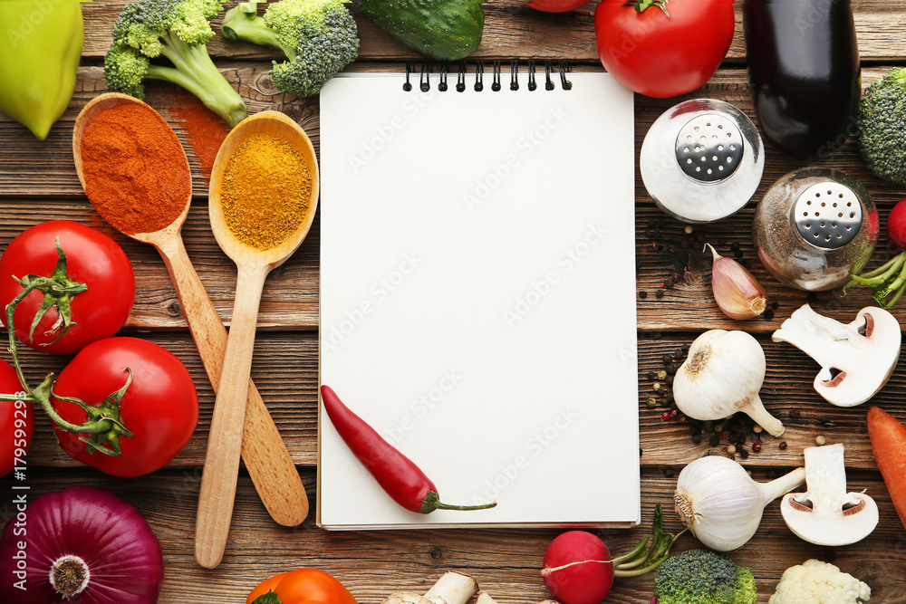 Fototapety, obrazy: Blank recipe book with vegetables on wooden table