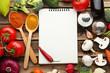 Leinwandbild Motiv Blank recipe book with vegetables on wooden table