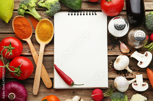 Fototapeta Blank recipe book with vegetables on wooden table obraz