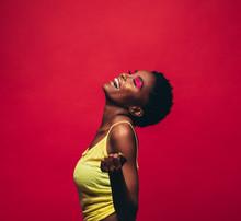 Cheerful Young Woman Dancing In Studio