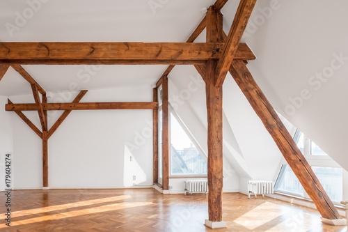 empty loft room with wooden framework and parquet floor Fototapet