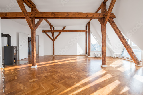 Obraz luxury apartment , empty loft room with fireplace and wooden beams - fototapety do salonu