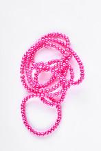 Pink Plastic Nacklace On White Background. Beautiful Beads Necklace Isolated On White Background.