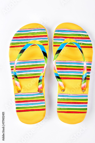 d96058448 Summer fashion striped slippers. Yellow flip flops in colorful stripes  isolated on white background. Fashion beach footwear.