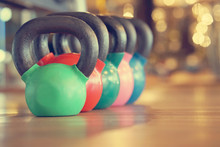 Colorful Kettlebells In A Row ...