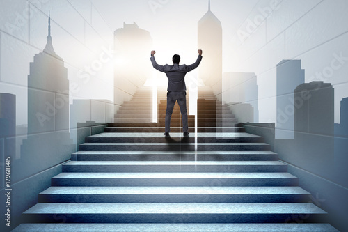 Businessman climbing up challenging career ladder in business co Fototapeta