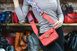 Fashionable woman with stylish red clutch, accessories