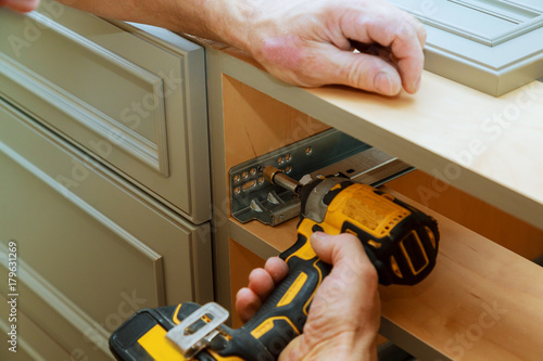 Fototapeta Adjusting fixing cabinet door hinge