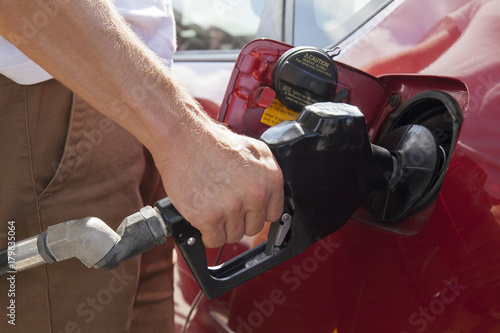 Fotografie, Obraz  Arm Refueling Car at Gas Station