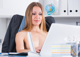 Topless businesswoman on laptop