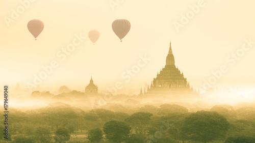 Fotobehang Zwavel geel Hot air balloon over plain of Bagan in misty morning, Mandalay, Myanmar