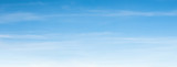 Fototapeta Fototapety na sufit - An aerial background view from of clear blue skies and white faint clouds - panoramic web banner