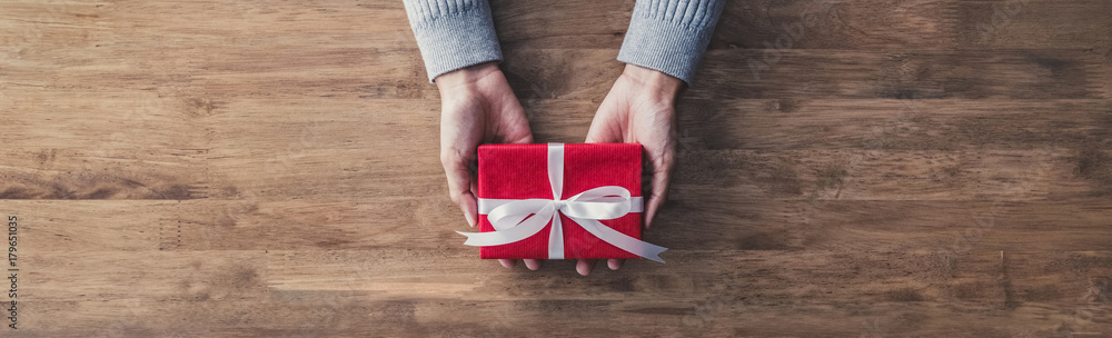 Fototapety, obrazy: Woman giving a christmas or birthday gift - web banner