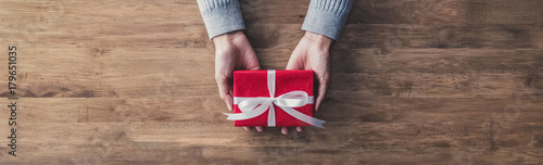 Woman giving a christmas or birthday gift - web banner