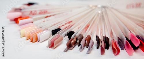 Staande foto Manicure manicure colorful artificial nails in beauty shop
