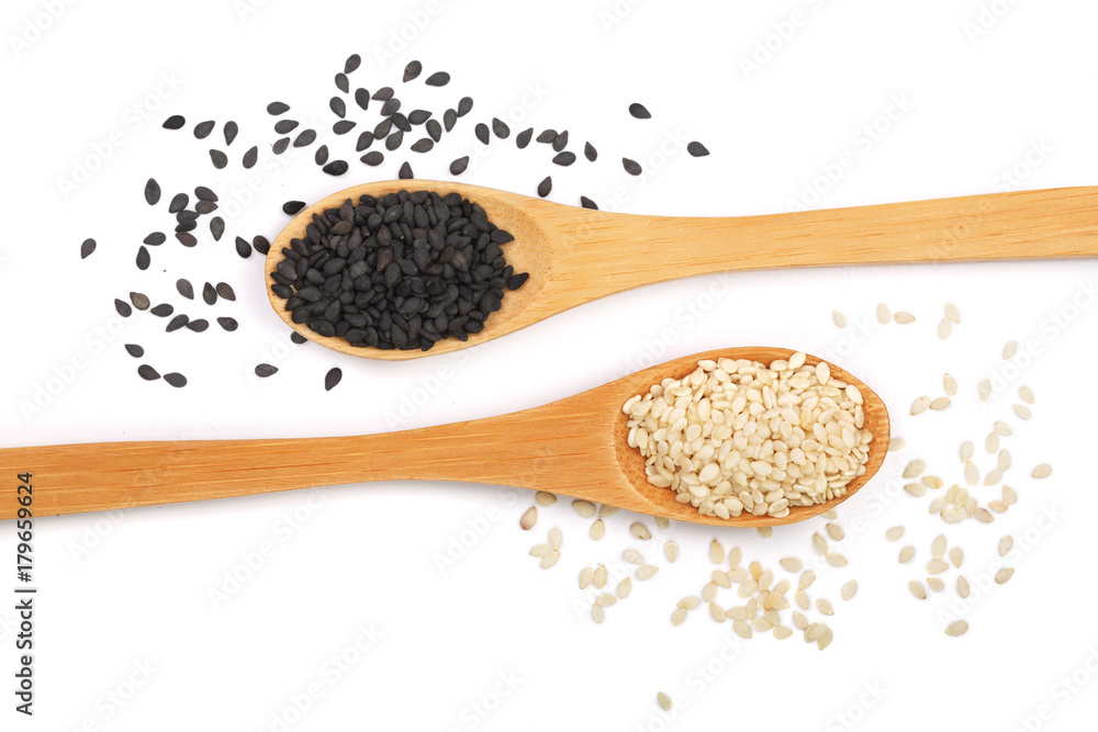 Fototapety, obrazy: Black and white sesame seeds in a wooden spoon isolated on white background top view