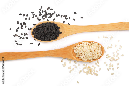 Black and white sesame seeds in a wooden spoon isolated on white background top Canvas Print