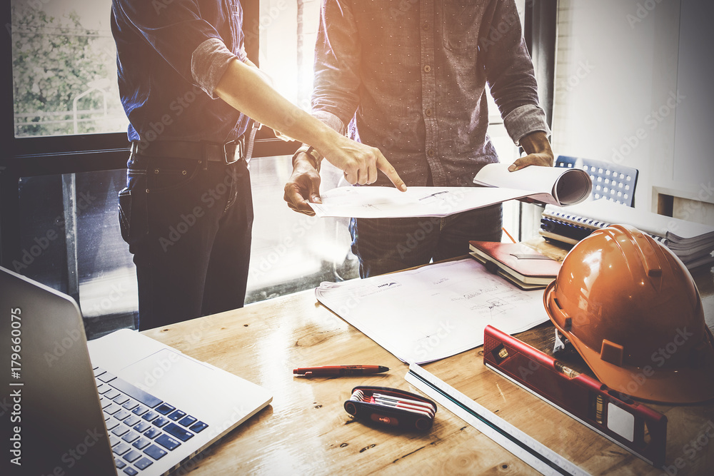 Fototapety, obrazy: Two Architect man working with compasses and blueprints for architectural plan,engineer sketching a construction project concept.