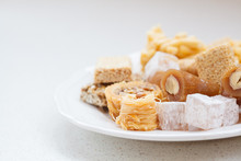 Variety Of Honey Oriental Sweets In A White Plate