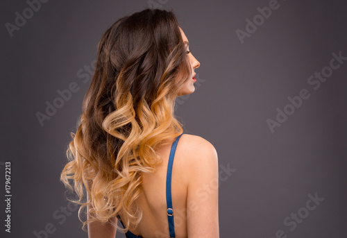 Fotografie, Obraz  Woman with Long Healthy Colorful Ombre Wavy Hair